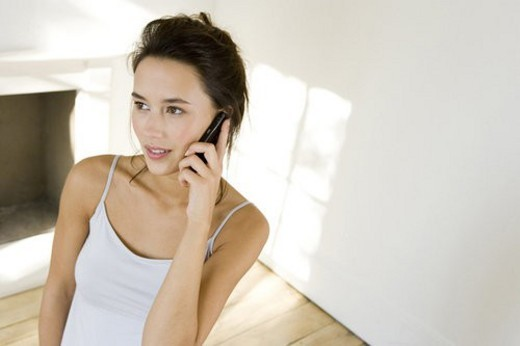 A young woman using a mobile phone : Stock Photo