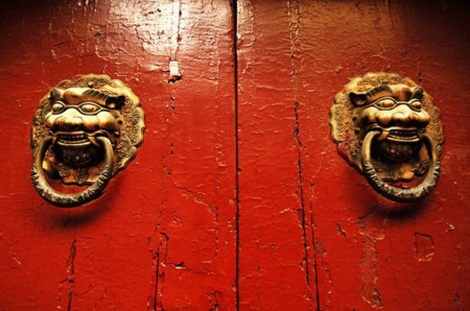 Two traditional Chinese door knockers in shape of lion head, Beijing, China : Stock Photo