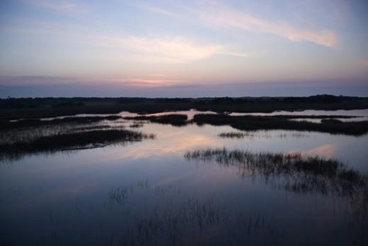 Stock Photo: 4029R-423375 Sky reflecting in water in marsh area on Bald Head Island, North Carolina.