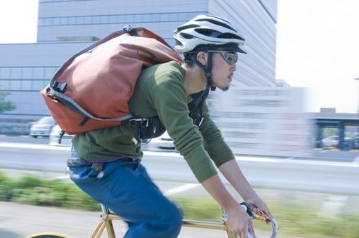 Stock Photo: 4029R-424427 The Messenger Who Runs By A Bicycle All Over A Town