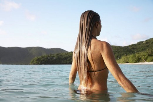 Stock Photo: 4029R-426424 Mid adult woman swimming in ocean, St. John, US Virgin Islands, USA