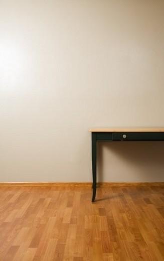Table on hardwood floor : Stock Photo