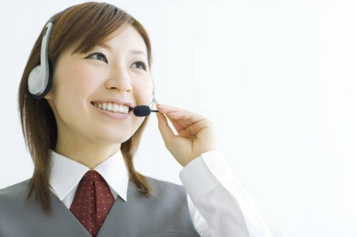 Smiling businesswoman wearing headset : Stock Photo