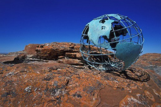 Globe on rock : Stock Photo