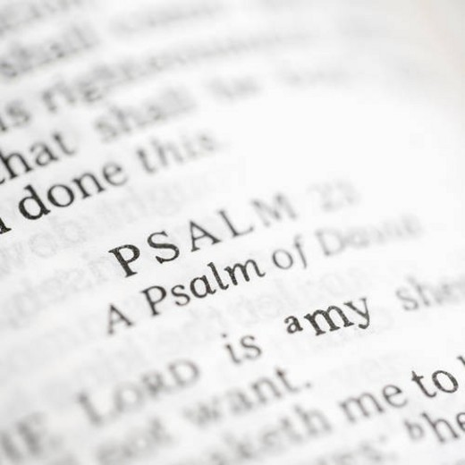 Stock Photo: 4029R-428746 Selective focus of Psalm verses in open Holy Bible.