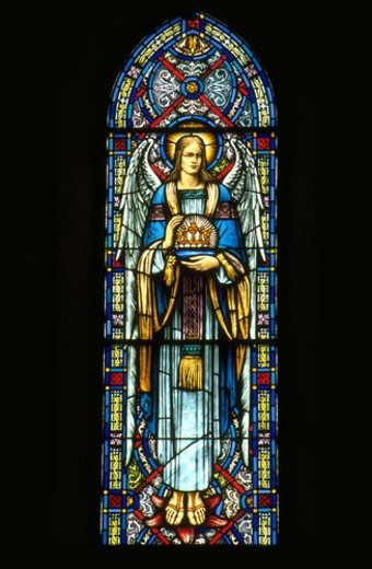 Angel holding crown stained glass window : Stock Photo