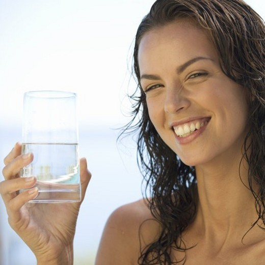 Stock Photo: 4029R-431854 A young woman drinking a glass of water