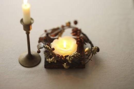 Burning candles, white background : Stock Photo