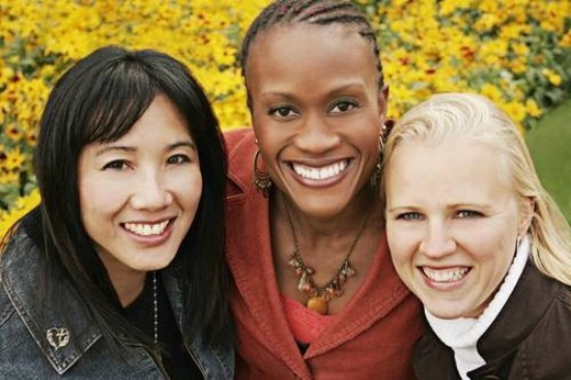 Multiethnic portrait of three women outdoors : Stock Photo
