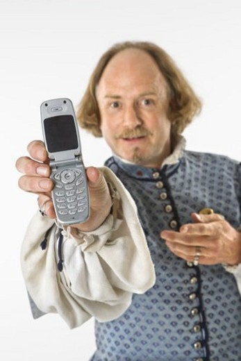 Stock Photo: 4029R-435333 William Shakespeare in period clothing holding cell phone towards viewer.