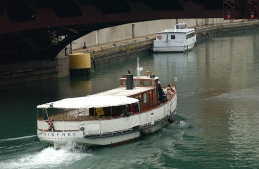 Motorboat passing under a bridge : Stock Photo