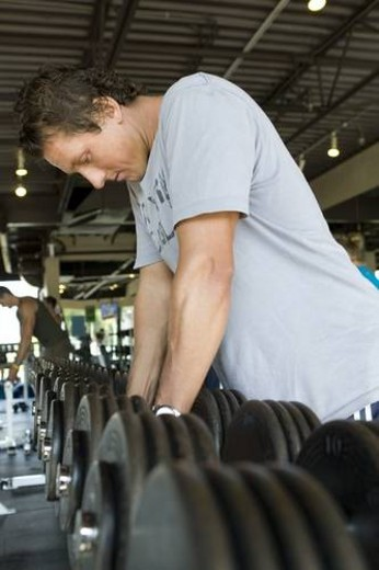Fit male exercising in a gym. Workout. : Stock Photo
