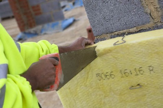 Stock Photo: 4029R-439235 Bricklayer cutting insulation panels for cavity wall
