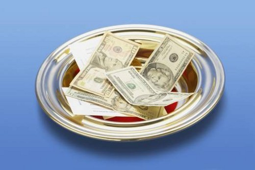 Stock Photo: 4029R-440074 knoxville, tennessee, united states of america; american money in a church offering plate