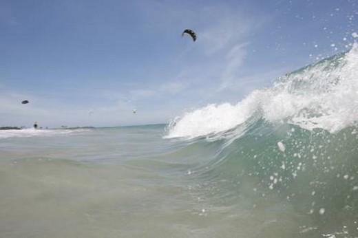 kite boarding at kite beach in the Dominican Republic : Stock Photo
