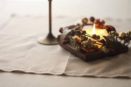 Stock Photo: 4029R-443926 Burning candle, close up, white background