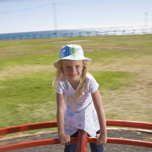 Stock Photo: 4029R-444115 A young girl on a playground