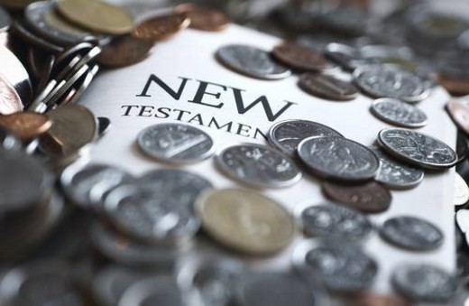 Stock Photo: 4029R-44804 Coins covering the New Testament Bible
