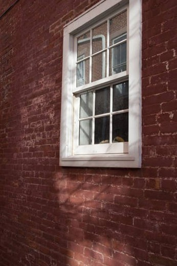 Windows and brick exterior of a building in the Hamptons : Stock Photo