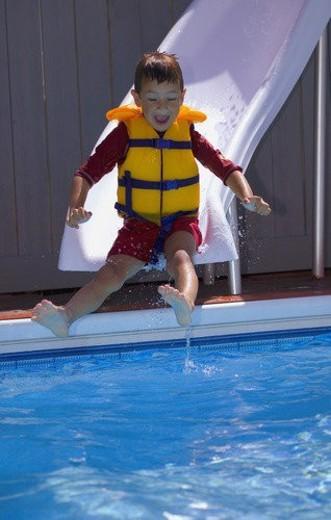 Boy on waterslide : Stock Photo