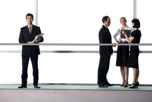 Group of business colleagues in modern office building : Stock Photo