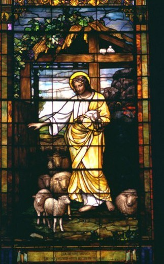 Jesus the Good Shepherd depicted on stained glass : Stock Photo