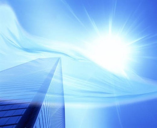 Flowing material over a bright sun and skyscraper : Stock Photo
