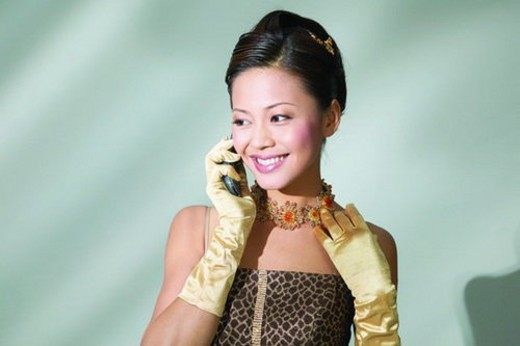 Stock Photo: 4029R-49835 Black Hair, Colored Background, Chinese Ethnicity, Asian Ethnicity