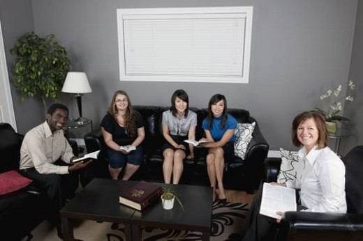 Stock Photo: 4029R-50839 a group of people having a bible study