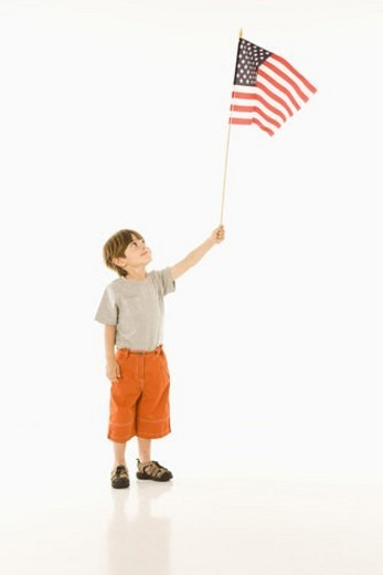 Boy holding American flag against white background. : Stock Photo