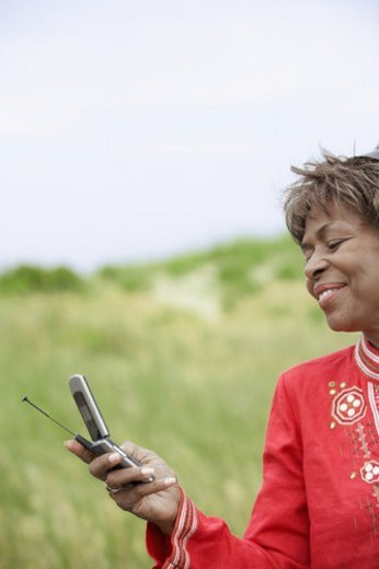 Woman text messaging : Stock Photo
