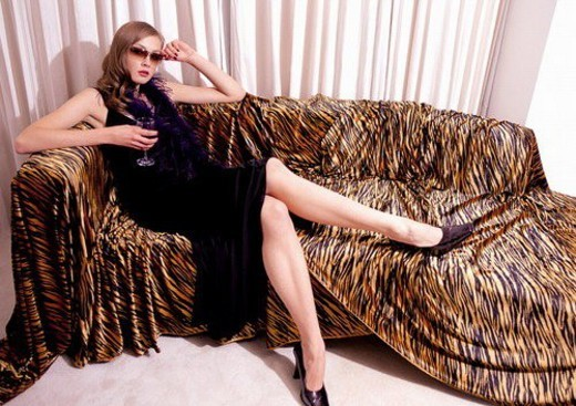 designer dress, young woman, carpet, home interior, glass, fashion, portrait : Stock Photo