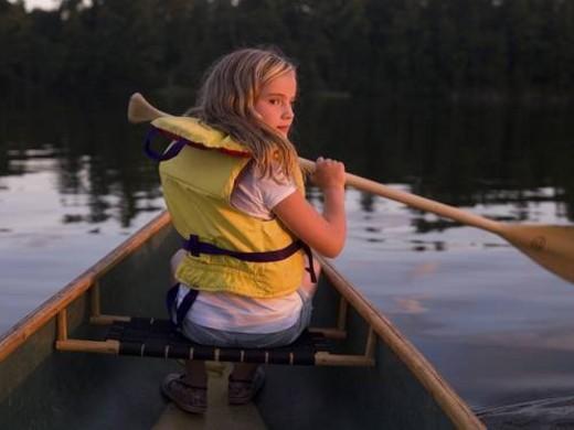 Stock Photo: 4029R-5519 Girl in canoe