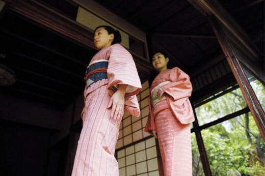Women putting on a kimono : Stock Photo