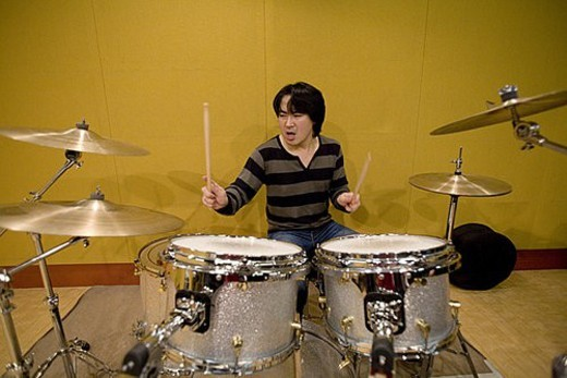 Young man playing drums : Stock Photo