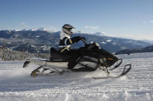 Stock Photo: 4029R-58052 snowmobile adventure tour in Whistler British Columbia