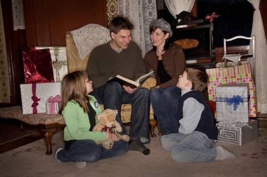 Stock Photo: 4029R-60212 Family reading a story at Christmas time