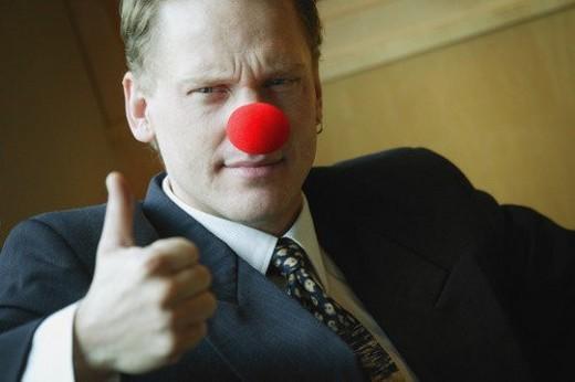 Stock Photo: 4029R-61351 Businessman wearing clowning around
