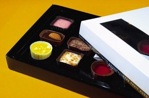 Stock Photo: 4029R-61643 Chocolate, Chocolates, Sweet, Chocolates box, Dessert, Present