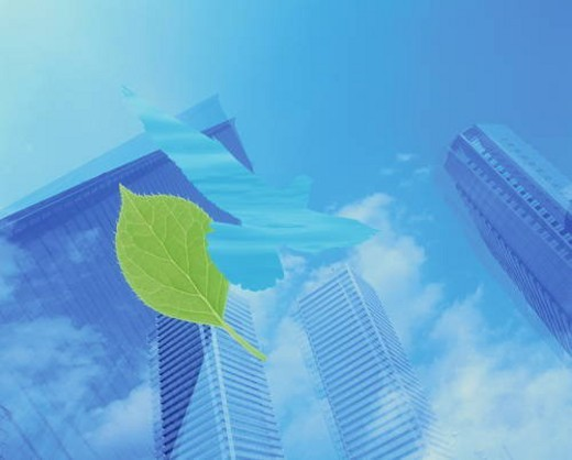 Abstract view of skyscrapers with leaf and pigeon motif : Stock Photo