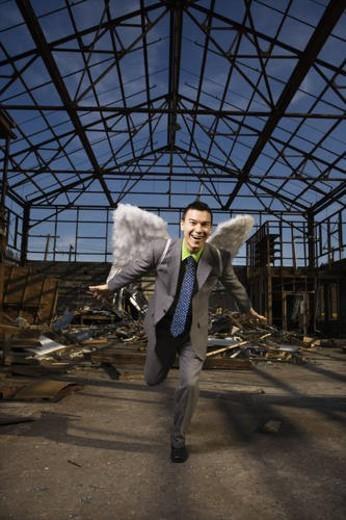 Businessman Wearing Angel Wings : Stock Photo