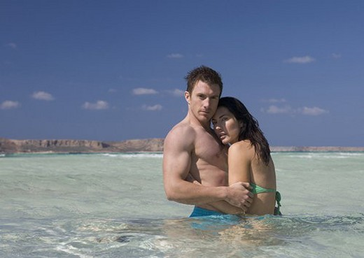 Stock Photo: 4029R-63162 A couple standing in the sea