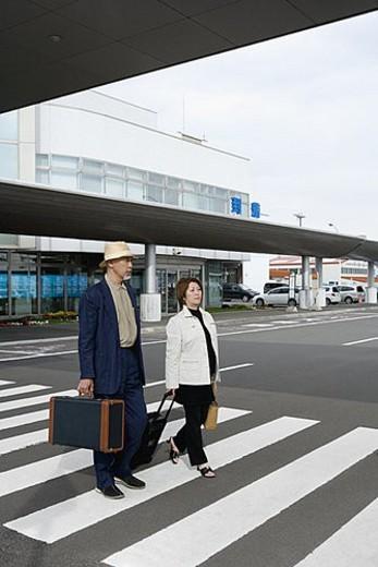Stock Photo: 4029R-63269 Senior couple walking outside airport