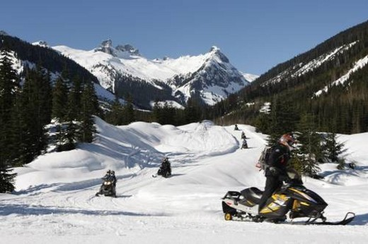 Stock Photo: 4029R-63620 snowmobile adventure tour in Whistler British Columbia