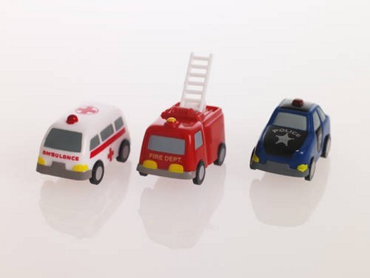Close-up of a toy ambulance with a fire engine and a police car : Stock Photo