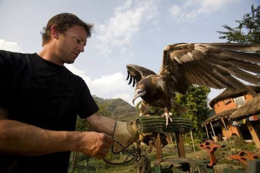 Stock Photo: 4029R-64868 Man with Egyptian vulture(Neophron percnopterus), Pokhara, Nepal