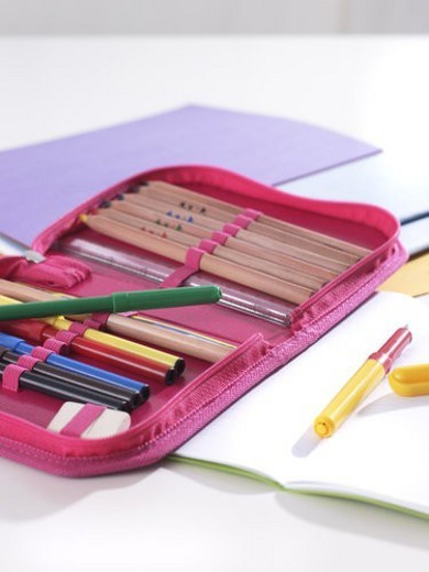 Close-up of pens and pencils in a pencil case : Stock Photo