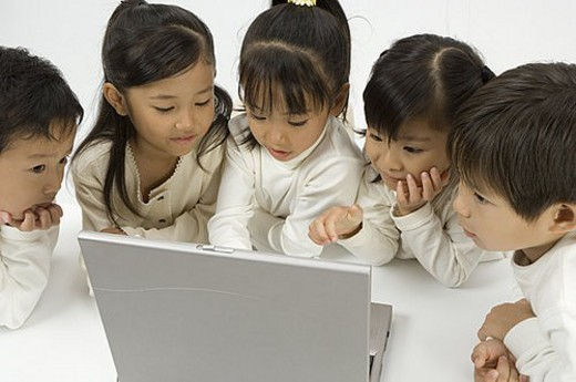 Five elementary age children using laptop : Stock Photo