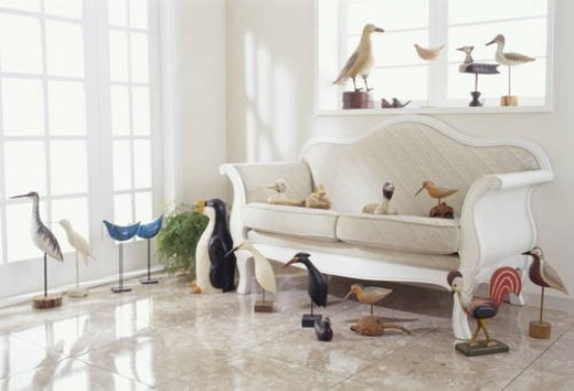 Stock Photo: 4029R-68515 Room with sofa and various wooden birds