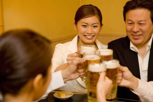 People Drinking at Izakaya : Stock Photo